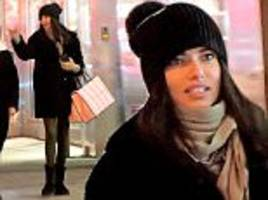adriana lima wraps up warm on shopping spree in new york