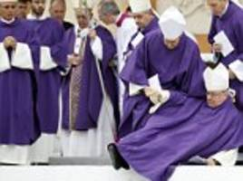 bishop collapses at the altar during pope's open air mass