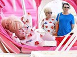 barbara windsor, 79, jets to barbados with scott mitchell