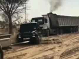 dubai prince sheikh hamdan helps out stuck truck driver