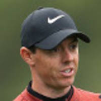 mcilroy grits it out to stay in grand slam hunt