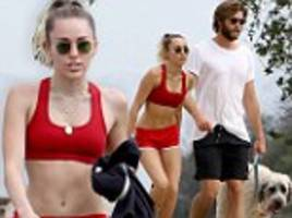 miley cyrus in red crop top for hike with liam hemsworth