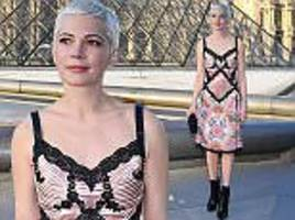 michelle williams cuts an elegant yet edgy figure in paris