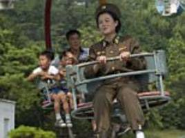 north korean soldiers pictured laughing and relaxing