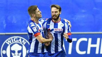 powell scores 11-minute hat-trick in thrilling wigan win