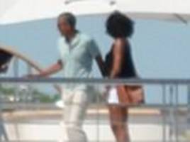 barack and michelle obama pose superyacht in tahiti
