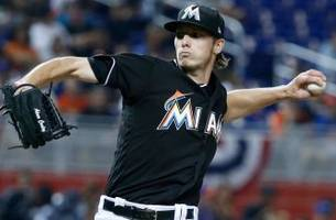 christian yelich, giancarlo stanton help marlins rally past mets