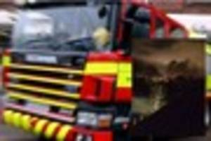 Firefighters deal with blaze after arsonists torch three HGVs