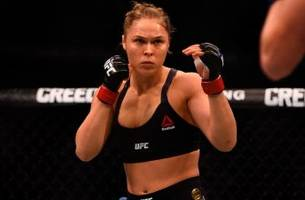 dana white says ronda rousey hasn't officially retired but he doesn't expect her back