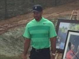 woods hits first public golf shots in over two months