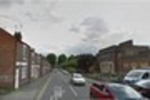 Man throwing debris from town centre building forces road...