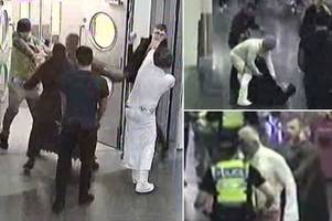 'princess leia and chewbacca' dad and son caught on cctv in drunken train station brawl with football fan