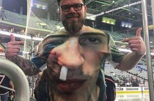 zach werenski gives signed jersey to blue jackets fan wearing his fractured face on a t-shirt