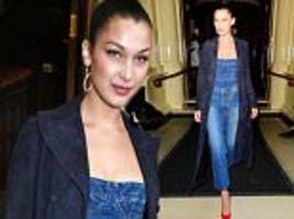 bella hadid wears denim corset tucked into jeans in london