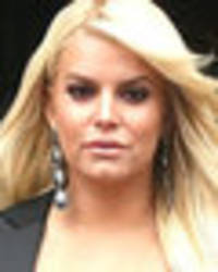 Jessica Simpson flashes nipples as she suffers epic wardrobe malfunction