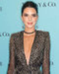 kendall jenner oozes glamour as mind-boggling cleavage and pins compete for attention