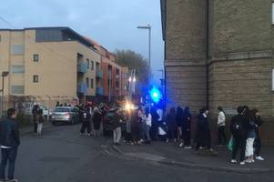 More than a hundred students evacuated in Cambridge as firefighters battle blaze in accommodation building