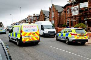 Specialist police officers rush to reports of dangerous dog attack in quiet Ayr street