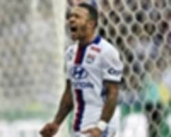Former Man Utd winger Depay celebrates in bar after Lyon secure Europa League progress