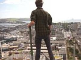 daredevils scale tall building in south-west england