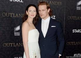 'outlander' stars sam heughan and caitriona balfe bring on-screen romance to real life in cape town