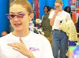gigi hadid is simply chic as she shops for party supplies