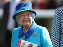 beaming queen watches as her horse wins at newbury races
