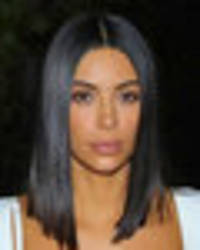 Kim Kardashian close to busting out of bra in eye-poppingly racy outfit