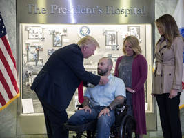 trump congratulates wounded soldier, awards him purple heart