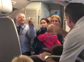American Airlines Suspends Employee in Heated Confrontation with Passengers (Video)