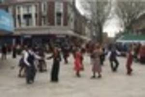 swing dancers turn heads with their powerful wartime performance...