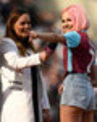 PIC SPECIAL: Pixie Lott dons West Ham kit with tiny shorts during half-time show