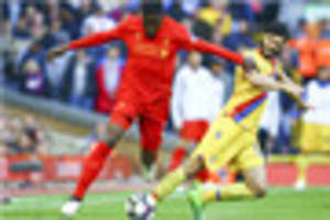 crystal palace defender leaves liverpool on crutches and in...