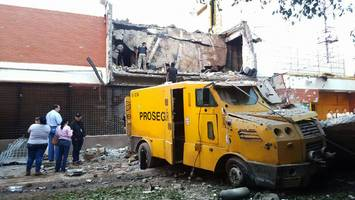 in spectacular heist dozens of heavily-armed robbers steal $40 million from paraguay vault