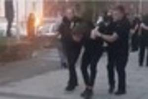 12 officers called to street violence
