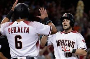 Owings hits grand slam, Greinke fans 11 as D-backs hold off Padres