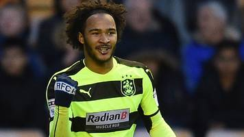 huddersfield beat wolves to secure play-off place