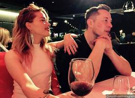 amber heard and elon musk have been a couple for 'a while,' and he 'is very attentive' to her