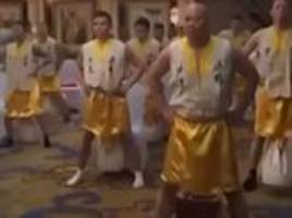 Martial arts trainees swing boxes from PRIVATE PARTS