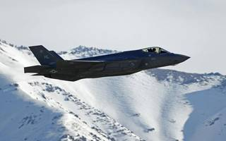 Lockheed Martin revises earnings as margins are squeezed