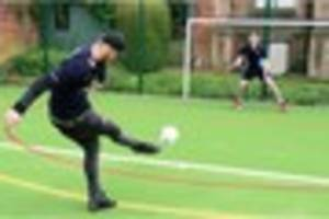 stoke city's marko arnautovic gets in some extra penalty practice...