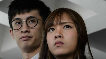 Hong Kong disqualified activists charged with illegal assembly