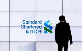 standard chartered shares leap as profits double
