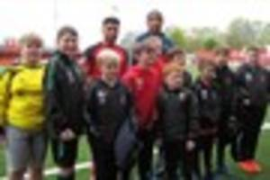 watford fc favourite makes it a special day for  juniors