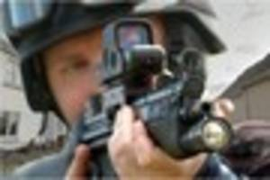 Armed officers arrest two in firearms incident