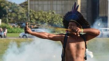 Indigenous Brazilians bring bows and arrows to protest