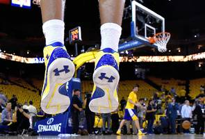 under armour spikes after losing less money than expected (ua)