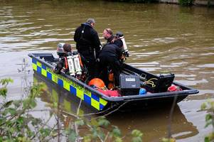 divers search feeder canal after husband and wife die as car plunges into water
