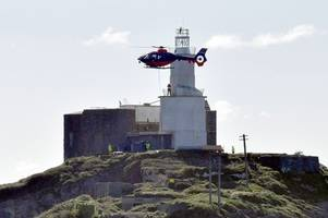 watch as helicopter completes james bond-style manoeuvres above ship in swansea bay