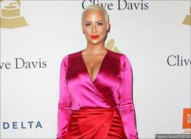 Amber Rose Holds Hands With a Man While Leaving Nightclub